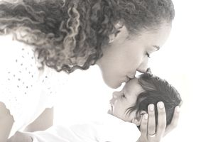 woman kisses a child