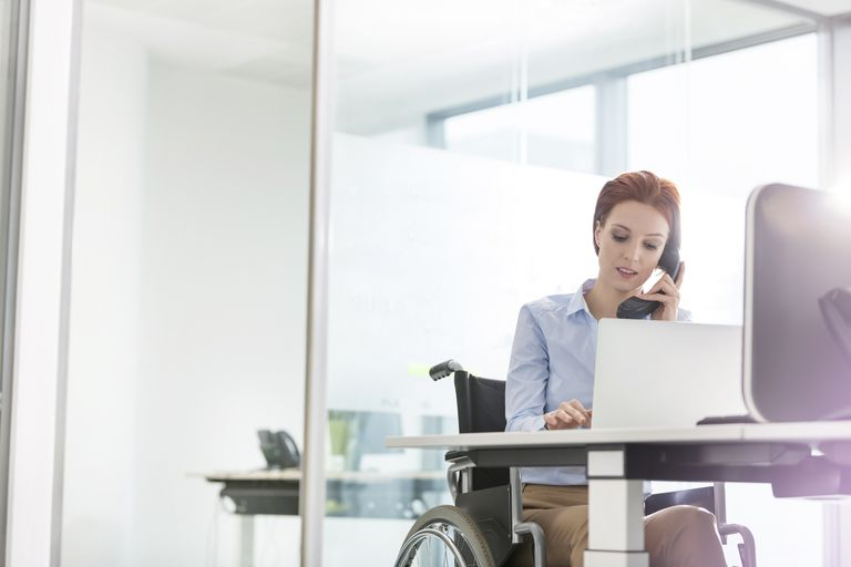 businesswoman in wheelchair at office