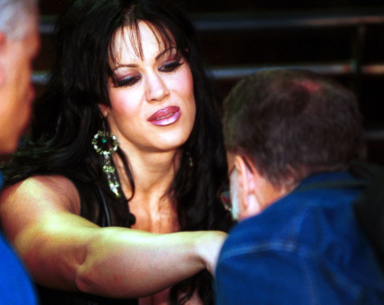 A fan kisses the hand of professional wrestler Chyna, September 28, 2000.