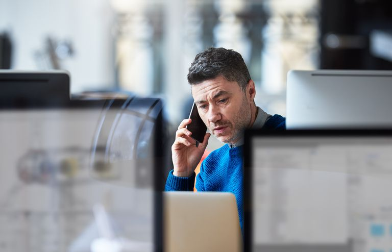 Businessman on the phone in a modern office