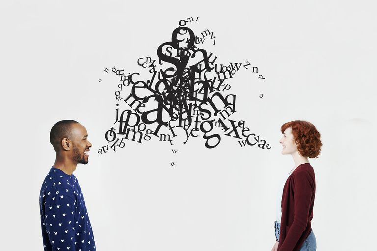 Man and woman with illustrated jumble of letters