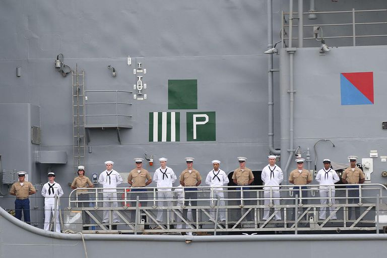 NEW YORK, NY - MAY 21: Sailors man the rails on the USS Oak Hill as it arrives for Fleet Week before 'The Last Ship' New York Fleet Week screening at Pier 92 on May 21, 2014 in New York City.
