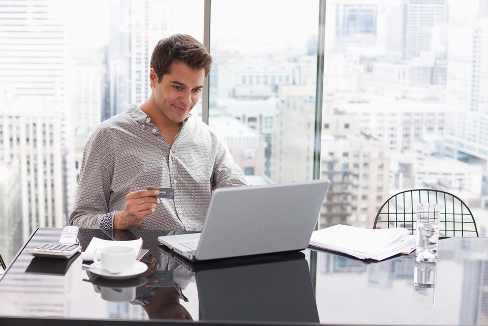 Businessman shopping online with credit card