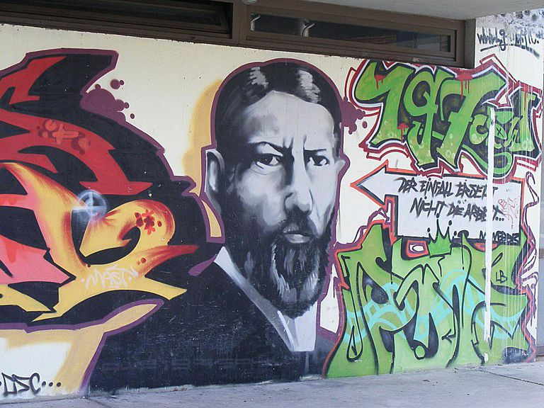 A graffiti portrait of Max Weber honors his work and contributions to sociology.