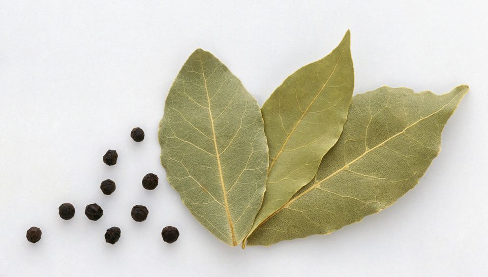 Bay leaves and black peppercorns