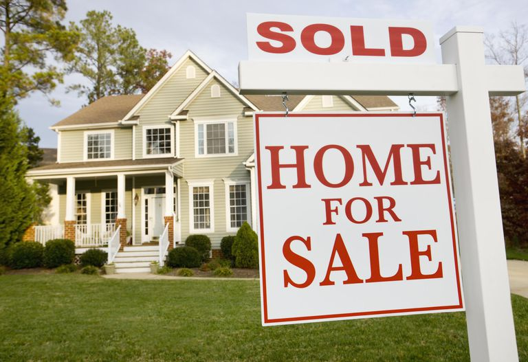 New Home with Sold Sign in Front Yard