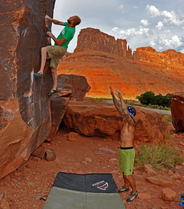 Logan Berndt spots Ian on a boulder problem at Big Bend near Moab, Utah.