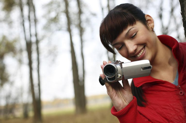 woman with a digital video camera
