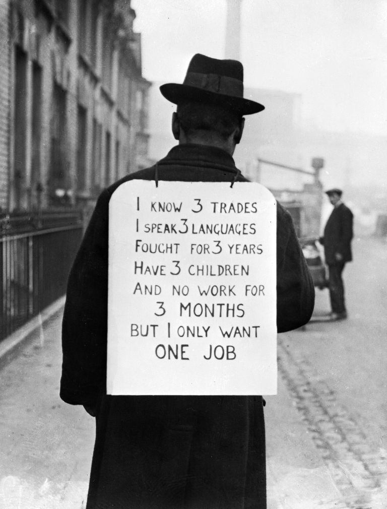 Man wearing sandwich sign looking for a job during the Great Depression\