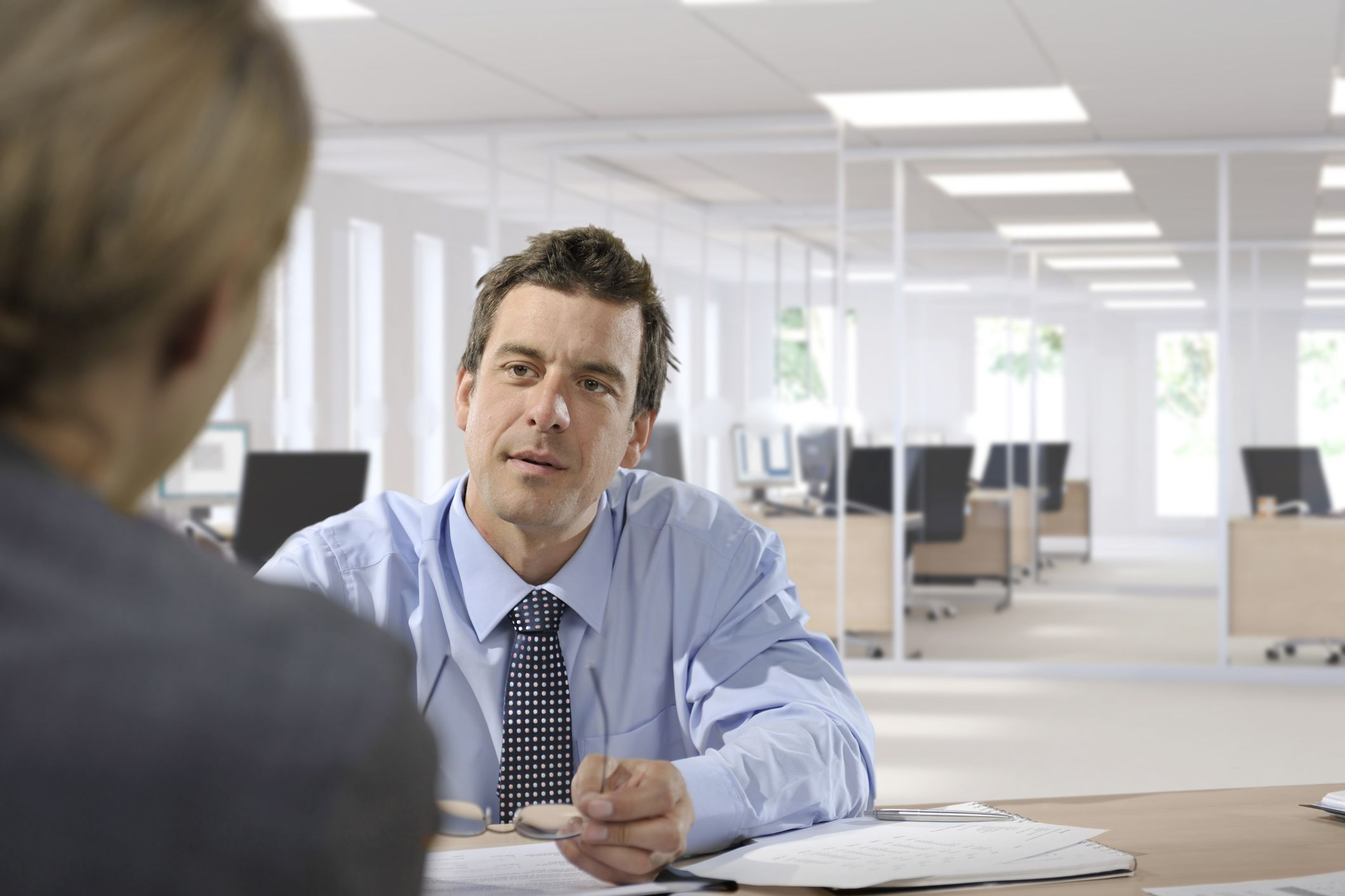 best answers for job interview questions about teamwork man at job interview - Teamwork Interview Questions And Answers