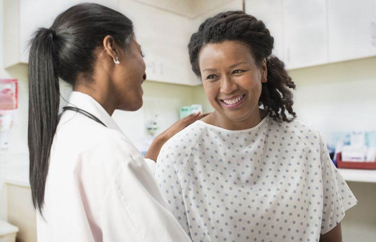 female doctor consoling female patient