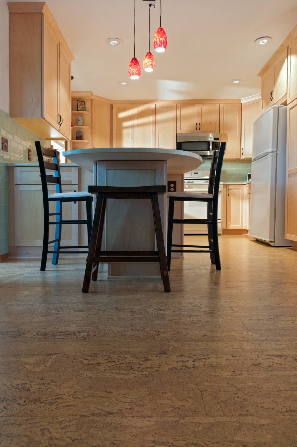 4 good and inexpensive kitchen flooring options eat in kitchen with light wood cabinets and cork flooring dailygadgetfo Image collections