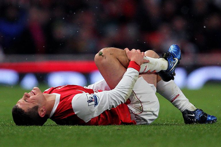 Jack Wilshere of Arsenal lies on the ground during the Carling Cup quarter final match between Arsenal and Wigan Athletic at the Emirates Stadium on November 30, 2010 in London, England