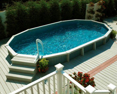 above ground swimming pool with wood deck