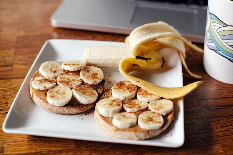Peanut butter and banana on an English muffin, double latte to drink.
