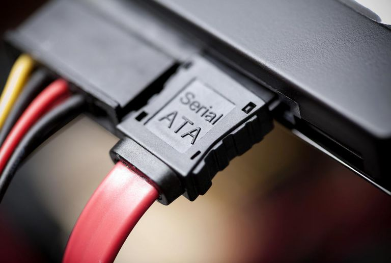 Close-up of a serial ata cable pluged in to a hard drive