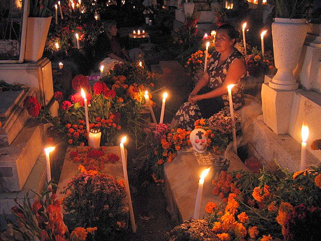 Woman in a cemetery on Day of the Dead