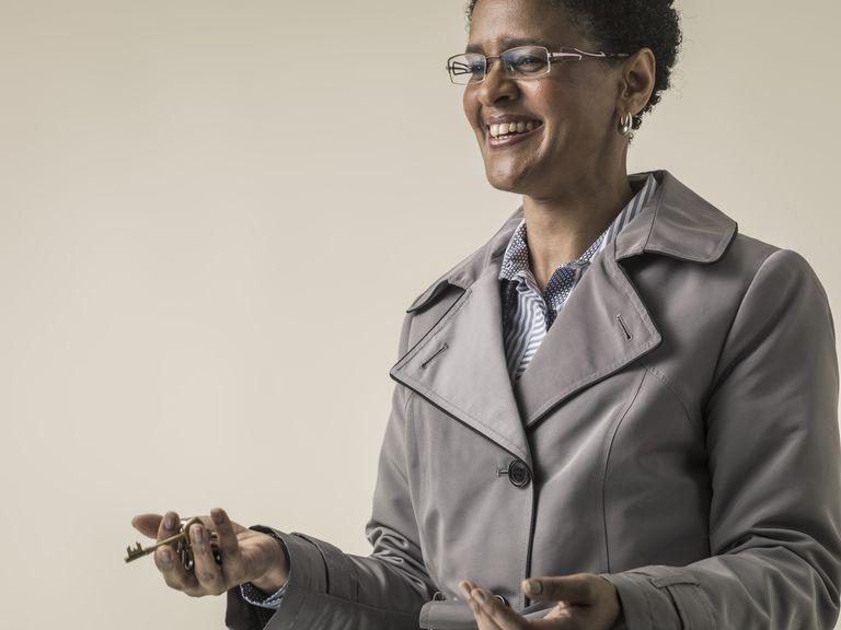 Black woman in coat holding keys