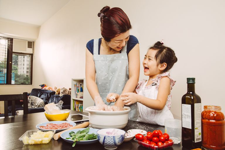 Mom & toddler mixing dough joyfully at home
