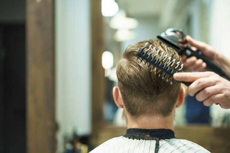 Man having hair cut at barber
