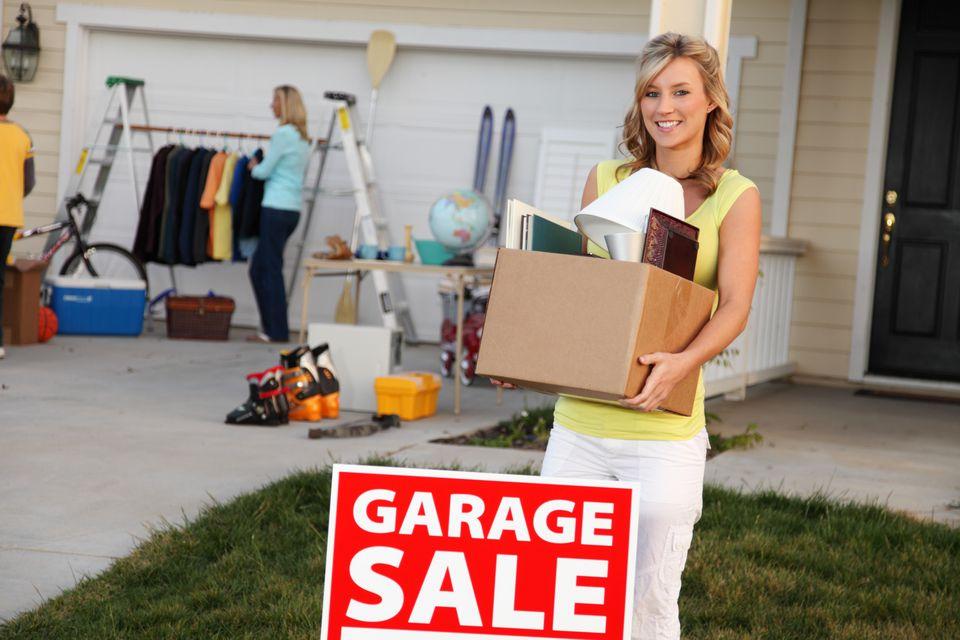 woman buying yard sale merchandise