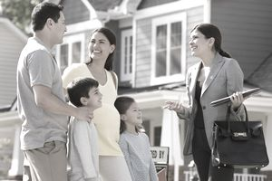 Young Family with Realtor in Front of New Home