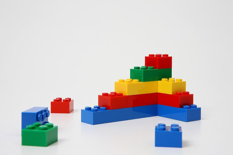 A lego structure symbolizes the interconnected and hierarchical nature of social structure.