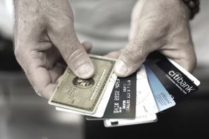 Credit Cards fanned out in a man's hands