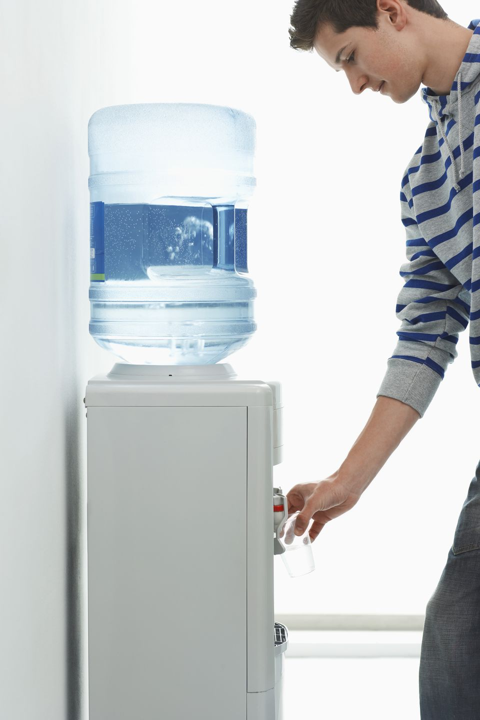 Office Worker Using Water Cooler