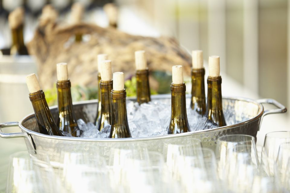 Wine bottles chilling in ice