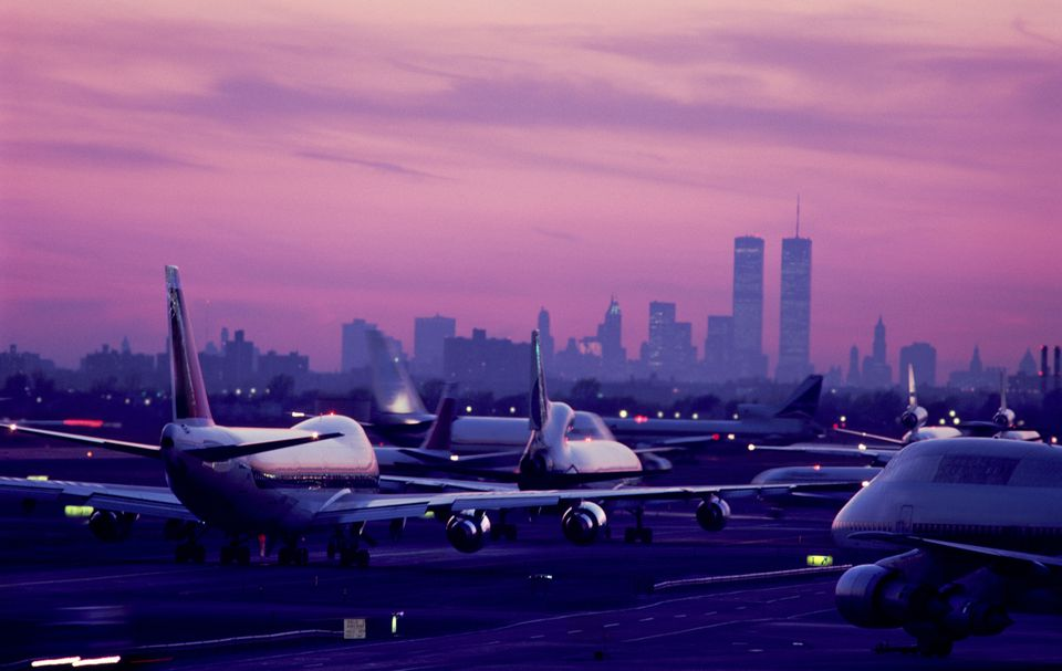 USA, New York City, JFK Airport, aircraft taxiing at sunset