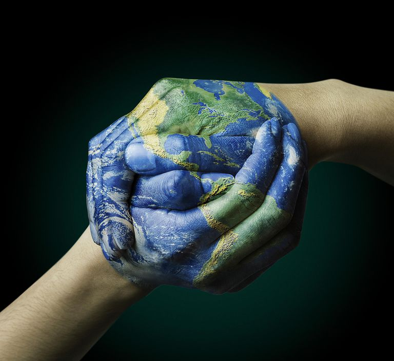 A fascinating picture of two hands painted as the Earth.