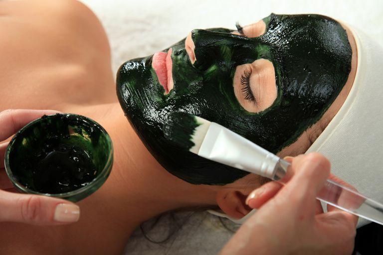 Woman getting a facial.