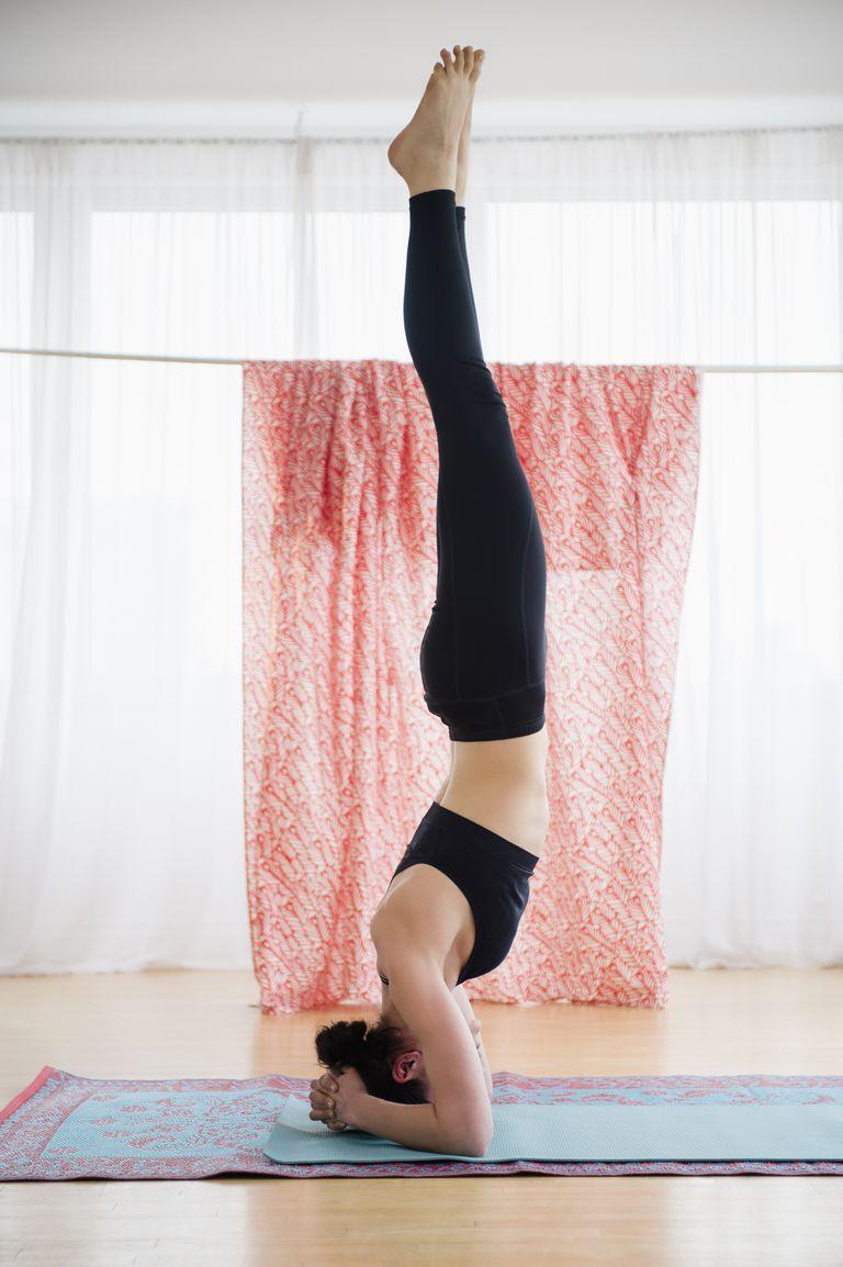 Caucasian woman practicing yoga