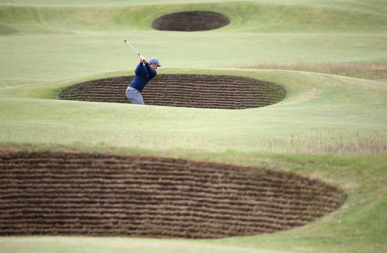 Paul Dunne of Ireland plays out of a bunker on the 5th hole during the third round of the 144th Open Championship at The Old Course on July 19, 2015
