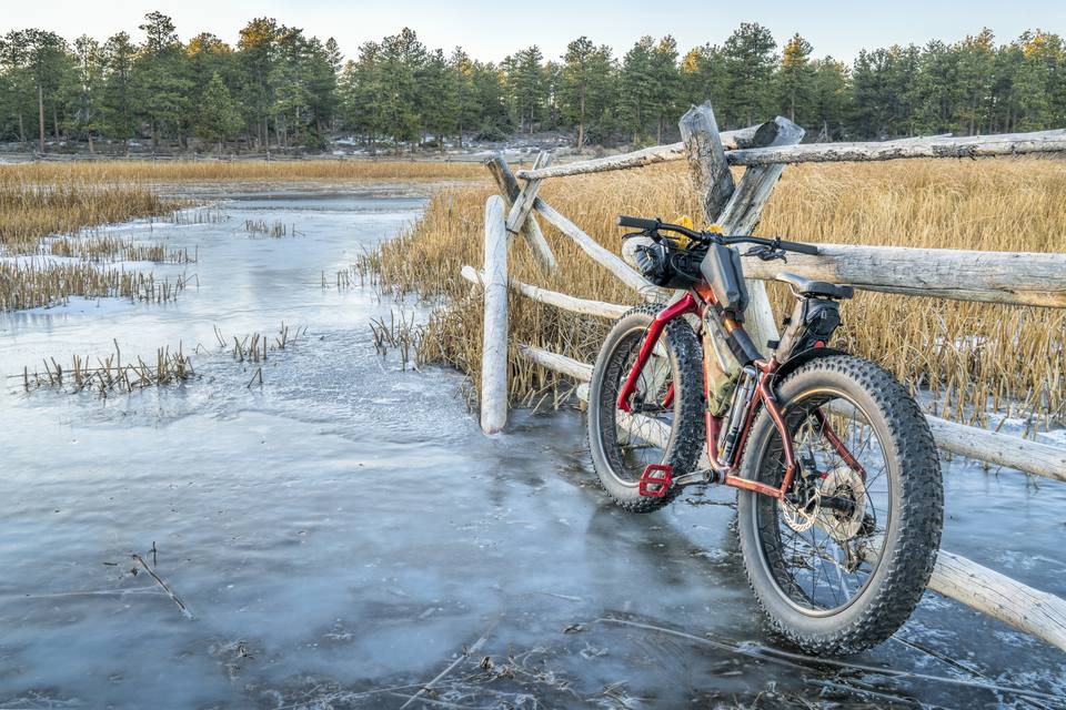 a fat bike on icy stream in Rocky Mountains