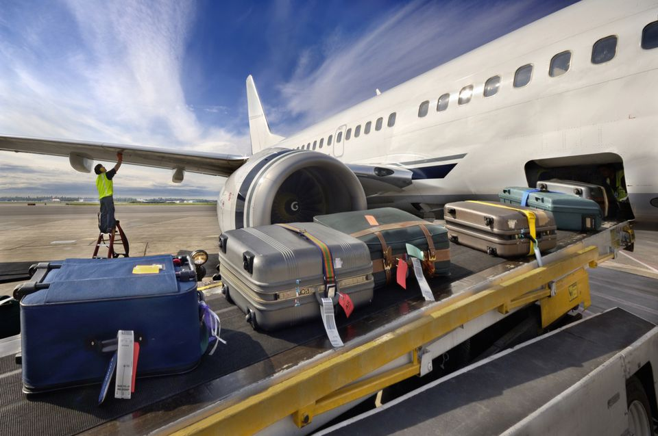 Loading airplane with luggage