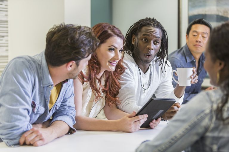 group of diverse multi racial business people meeting - Teamwork Interview Questions And Answers