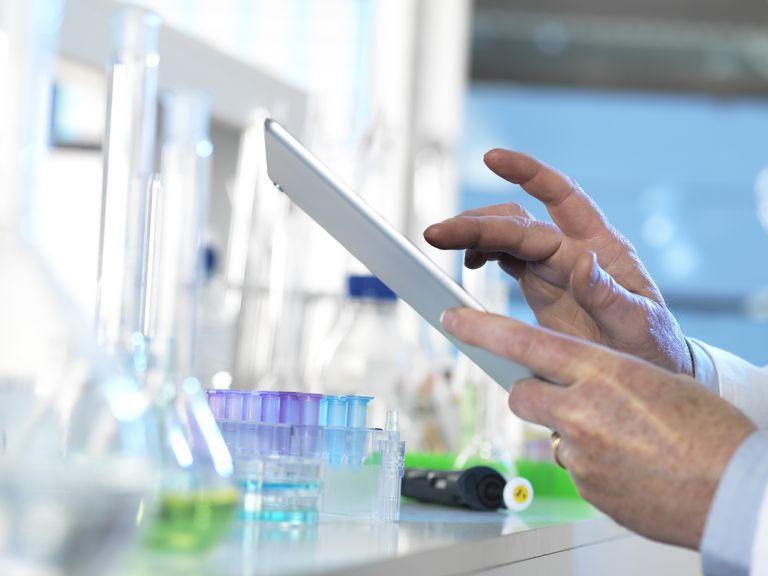 Scientist using a digital tablet
