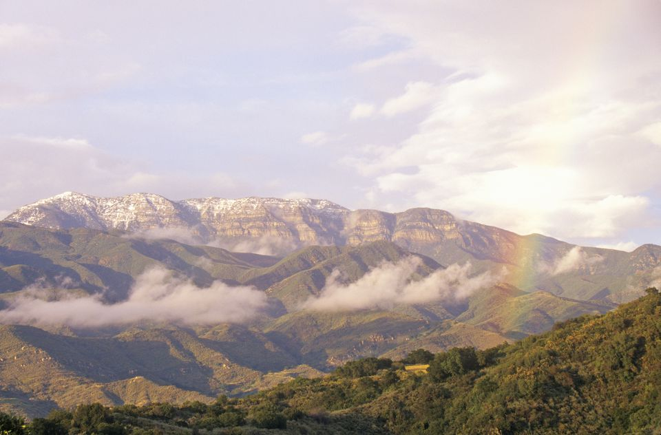 Rainbow and clouds over mountains