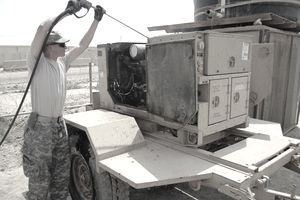 BAGHDAD—Spc. Bradley Berlau, a multichannel transmissions systems operator and maintainer with Company B, Special Troops Battalion, 2nd Advise and Assist Brigade, 1st Infantry Division, United States Division – Center and a Dallas Center, Iowa, native, cleans a generator prior to inspection for turn in on July 28 at Camp Liberty, Iraq. Theater-provided equipment, such as this generator, must be cleaned thoroughly before it can be turned in for refurbishment or transferred to another combat zone such as Afghanistan.