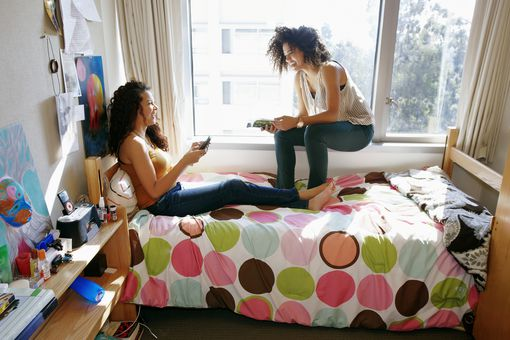 College students relaxing in dorm