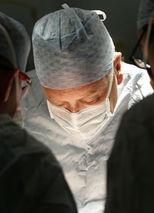 surgeon in surgery image, surgeon working in OR, in the operating room, surgeon image, surgery