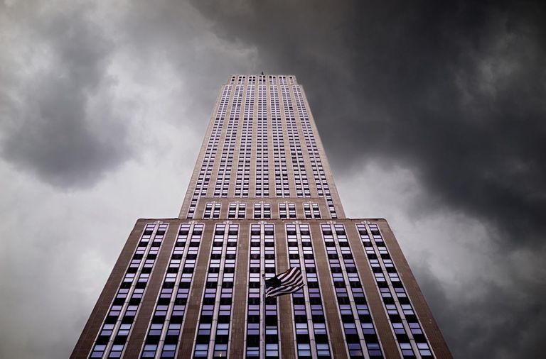 Empire State Building with storm clouds