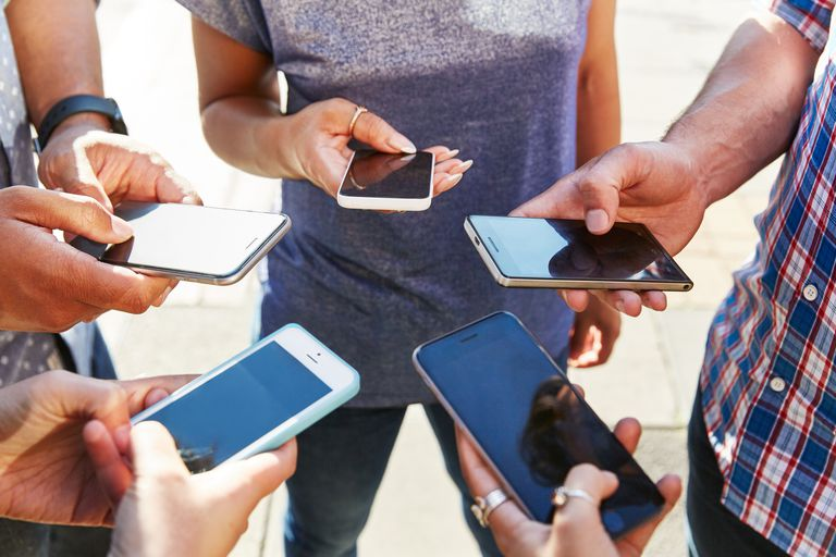 People in circle on phones