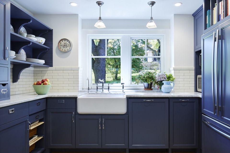 Blue Gray Kitchen Walls With Black Appliances And Slate Backsplash