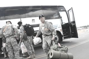 US Army Soldiers travel by bus