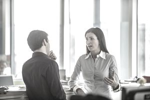 co-workers having serious conversation