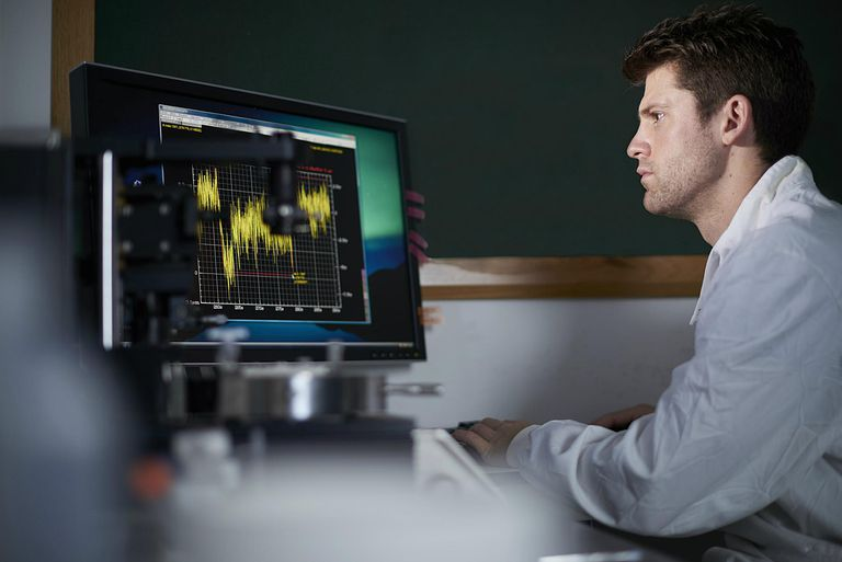 Researcher analyzing results on computer