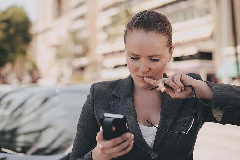 Business Woman Checking Phone Messages